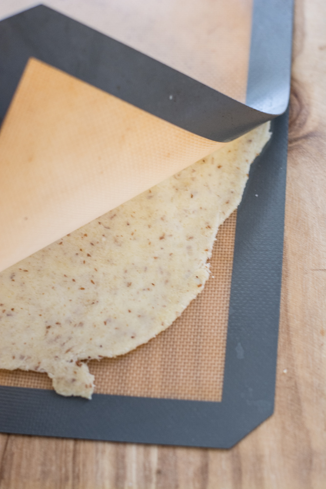 Learn how to make Keto Fat Head Dough perfect for keto pizzas, cinnamon rolls and more! This step by step tutorial will show you exactly how to make a crispy, delicious low carb crust!