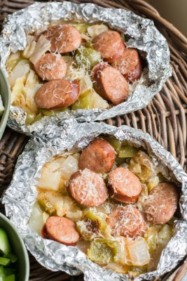 Keto Sausage and Cabbage Foil Packs are loaded with spicy sausage, bell pepper, onion, and cabbage in a cajun butter sauce! A perfect low carb meal for camping or grilling out! #keto
