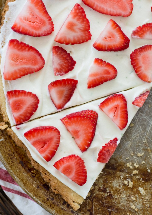 This Strawberry Limeade Keto Fruit Pizza features a sweet almond flour cookie crust, a refreshing lime frosting and a sweet strawberry topping! The perfect low carb dessert for all of your summer cookouts!