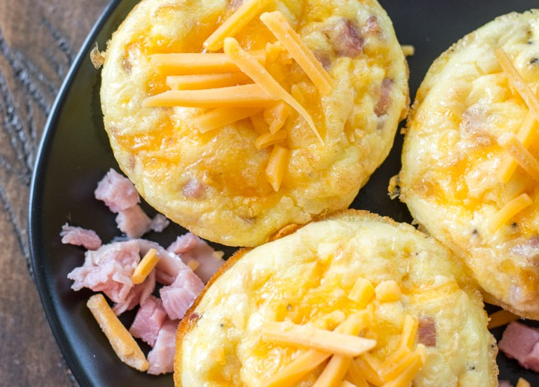 Try these Keto Ham Egg and Cheese Muffins for the ultimate low carb grab and go breakfast! At only one net carb each these muffins are perfect for keto meal prep! #keto #mealprep