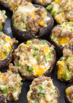These easy Keto Jalapeno Popper Stuffed Mushrooms are loaded with sausage, peppers and cheese! This is the perfect low carb keto dinner or appetizer at only 5 net carbs per serving!