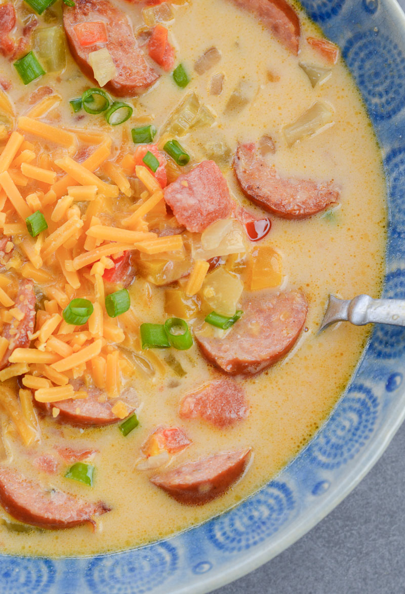 This Cheesy Smoked Sausage Soup is loaded with spicy sausage, tender vegetables in a creamy, cheesy sauce! At less than 7 net carbs per serving this is a great low carb, keto-friendly soup!