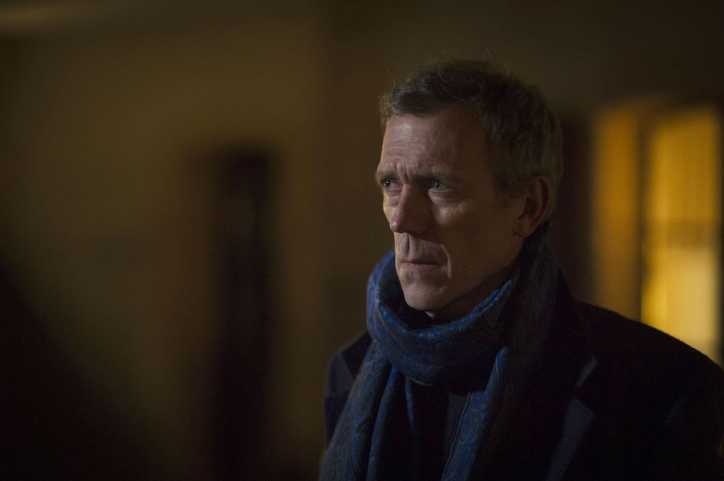WARNING: Embargoed for publication until 00:00:01 on 02/01/2016 - Programme Name: The Night Manager - TX: n/a - Episode: The Night Manager - Early Release (No. Early Release) - Picture Shows: *STRICTLY NOT FOR PUBLICATION UNTIL 00:01HRS, SATURDAY 2ND JANUARY, 2016* Roper (HUGH LAURIE) - (C) The Ink Factory - Photographer: Des Willie