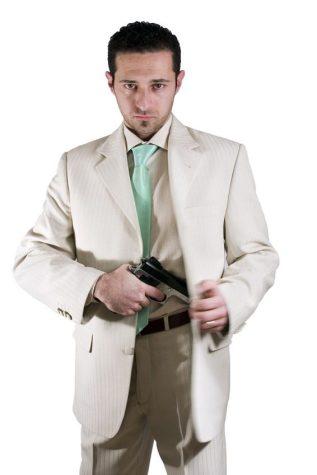 Man pulling out his gun