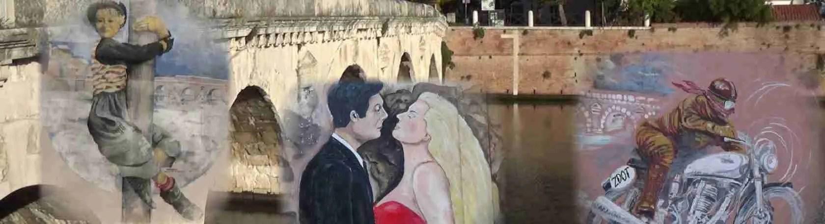Le escort Rimini adorano i murales di Borgo San Giuliano a Rimini, omaggio a Federico Fellini. Magica Escort