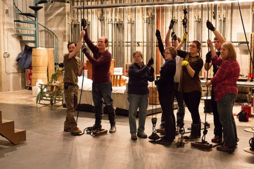The crew during a rehearsal for flying actors in Peter Pan. All the crew members are volunteers.