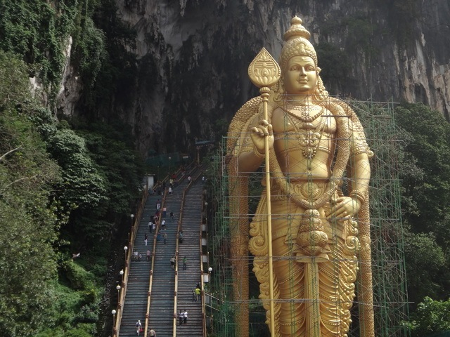A statue of Murugun and stairs. Lots of stairs.