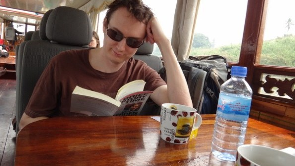 Andrew reading and drinking tea