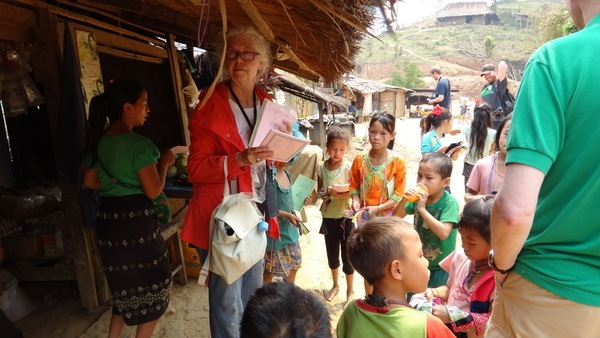 Giving school books to the children of the village