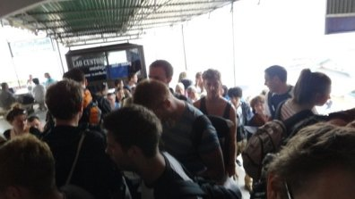 Waiting for our Lao tourist visas and passports with the massive crowd in Huay Xai