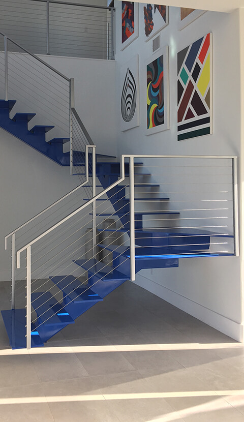 BLUE STAIRCASE WITH CABLE RAILING