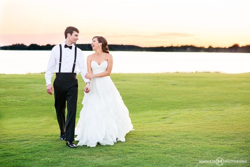 bride and groom at sunset on waterfront
