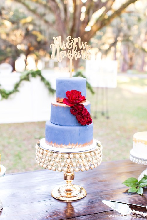 Blue, Red, & Gold Wedding Cake