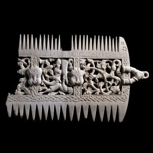 Elephant ivory liturgical comb from Britain, 11th century, showing what appears to be a battle scene, with one figure prostrate. Photo: British Museum.