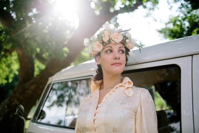 1970s vintage wedding boho bride with camper van and flower crown photo by Binky Nixon for the National Vintage Wedding Fair