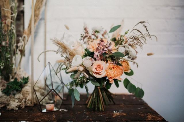 Boho Woodland Wedding with Black Wedding Cake and Autumnal Flowers