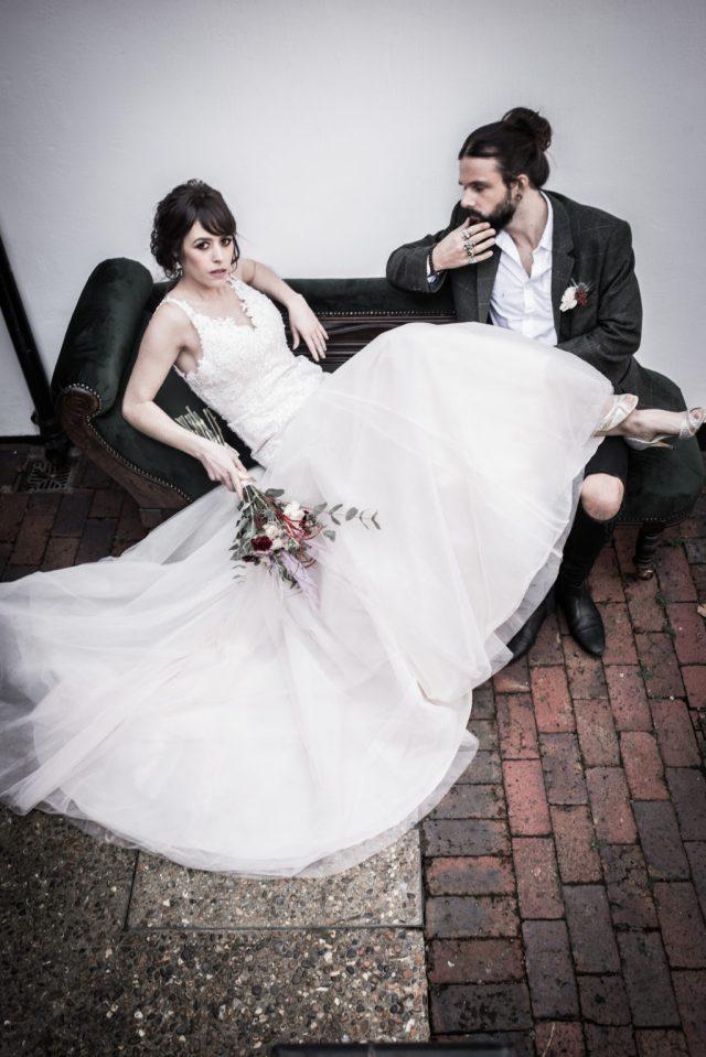 Classic Rock Wedding with Black Wedding Cake and Alternative Groom Style
