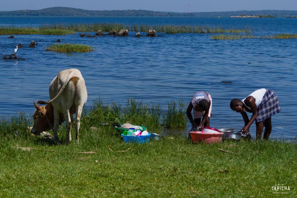 Girls washing by the lake on Mageta Island
