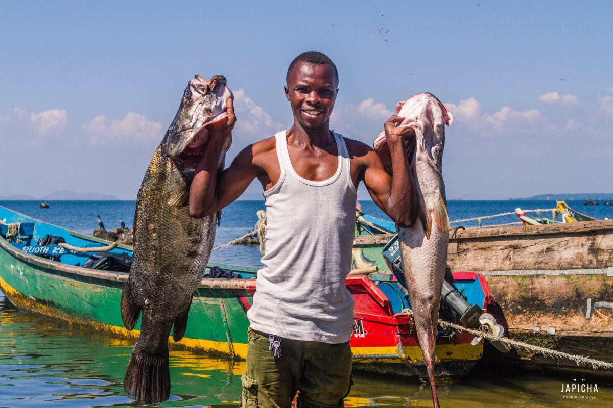 Otis JaKanyawegi with giant fish on Mageta Island