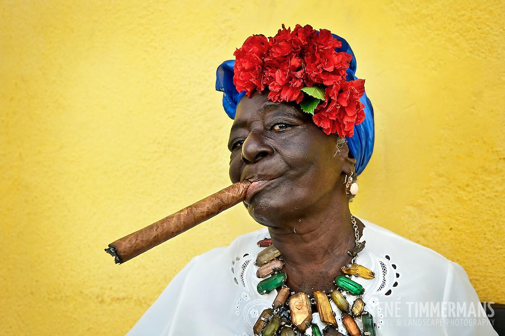 Havana, Cuban woman smoking cigar