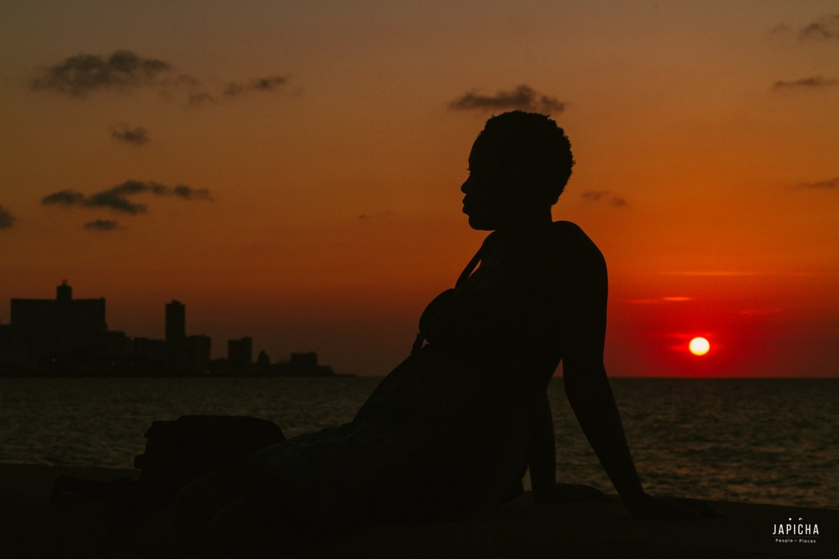 Jaber sitting on the Malecón at a sunset. | by Japicha
