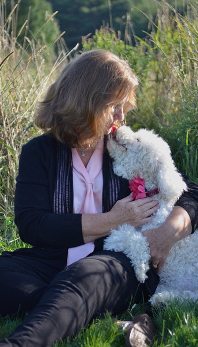 Image of Maile Hulihan, author of the Trinity of Bitches series, and her beloved dog, Cassie.
