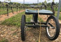 A vineyard seat on wheels