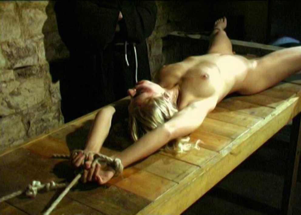 women stretched in the dungeon
