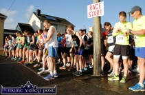 Watches being checked and set as the runners face up to the line at the start of An Riocht AC Couch-to-5K Road Race/Fun Run in Castleisland on Friday evening. ©Photograph: John Reidy