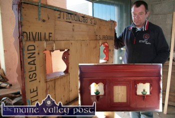 Leo Suijkerbuijk in his workshop in Breahig with an over-mantle made from Butter Box timber from the old T.S. Prendiville Millers and Merchants 95 - 97 Upper Main Street, Castleisland. ©Photographs:John Reidy.