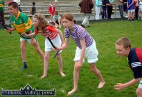 Fierce concentration on the faces of these young athletes at the start of one of the relay races during the 2004 Knocknagoshel Pattern Festival Sports. ©Photograph: John Reidy 15-8-2004