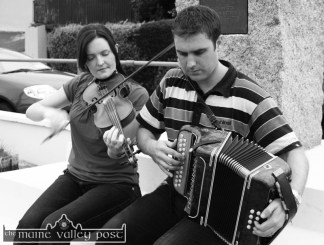 Aoife Ní Chaoimh and Paudie O'Connor playing at the base of the Patrick O'Keeffe monument in Scartaglin in August 2006. ©Photograph: John Reidy 6-8-2006