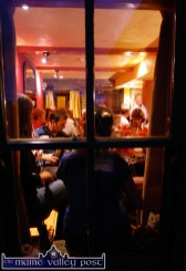 View from Outside: A traditional music session in progress in Tom Fleming's Bar in Scartaglin on Sunday night during the second annual but short-lived music festival in the village. ©Photograph: John Reidy 06/08/2006