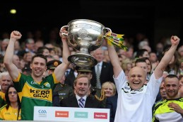 Marc Ó Se celebrates with Kerry team Physical Therapist, Ger Keane, Castleisland after winning the All-Ireland Football Final against Donegal as Taoiseach Enda Kenny takes it all at Croke Park 2014 ©Photo: Don MacMonagle