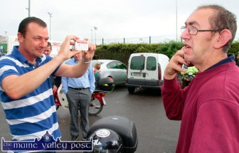 In great demand: Event organiser, Jim Griffin being photographed by a participant at the start of the annual Honda Fun Run in aid of Oileán Beó in Castleisland on Sunday morning. ©Photograph: John Reidy