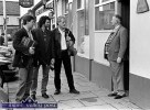 Singer and publican, Jimmy O'Brien giving a bar at the door of his bar in Killarney to Sliabh Notes trio: Donal Murphy, Tommy O'Sullivan and Matt Cranitch. ©Photograph: John Reidy 14-4-1996