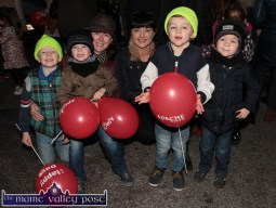 Waiting for Santa on Main Street on Friday evening were: sisters, Bernie Sinnott and Noreen McCarthy with: Shane and Adam and Tom and Ben. ©Photograph: John Reidy