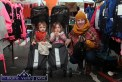 Stalling for Shelter: Noreen Sheehy from Duagh pictured with her children, Brendan and Molly sheltering in a clothing stall at Castleisland's annual November 1st Horse Fair on Saturday. ©Photograph: John Reidy