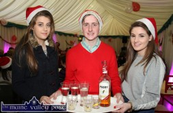 Serving up: Alison Jones (left) with: Paddy Flynn and Avril Fallon serving the needs of the gathering at the annual Cordal Senior Citizens' Christmas Party at the Christmas Marquee on Sunday. ©Photograph: John Reidy