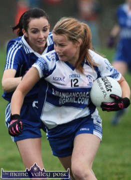 Desmonds wing-forward, Andrea Murphy gets by the challenge of Clonbur wing-back, Paula Nic Gearailt during their All-Ireland Intermediate Ladies' Football final in Corofin on Saturday. ©Photograph: John Reidy
