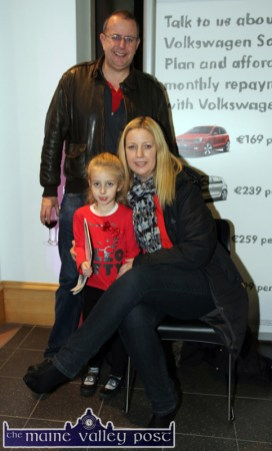 Tralee copuple, John Finn and Amanda Walsh pictured with their little girl, Cliodhna at the launch of the eighth generation Passat Variant at S. Divane & Sons in Castleisland on Friday night. ©Photograph: John Reidy