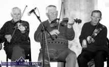 Scart Centre Opening: From left: Paddy Cronin, Mikey Duggan and Willie O'Connell playing at the official opening of the Scartaglin Haritage Centre in May of 2000. ©Photograph: John Reidy 19-5-2000
