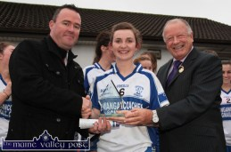 Desmonds centre-back Cáit Lynch receiving the TESCO Player-of the-Match award from Presinent of the Ladies Gaelic Football Association, Pat Quill (right) with Paul O'Loughlin of TESCO after the final in Corofin, Co. Clare. ©Photograph: John Reidy 29-11-2014
