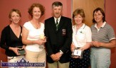 Castleisland Golf Club Captain, Dano Dennehy pictured after the presentation of his prizes at the clubhouse on Sunday night 20/6/04. The winners included, from left: Nancy Fleming, 1st; Moira Quinlan, 3rd; Joan Costello, 2nd and Máire Geaney, 4th. ©Photograph: John Reidy 20/06/2004