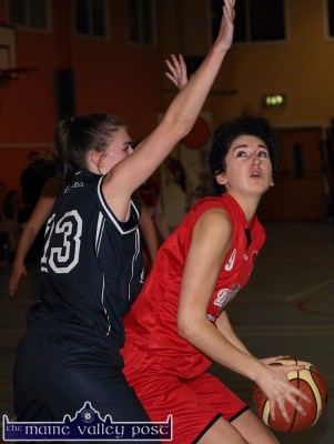 St. Mary's/Team Den Joe's American Style's Nessa Sheehy eyes the basket as NUIG's Lauren Murray tries to prevent the damage during their Women's National League Division 1 game at Castleisland Community Centre on Saturday night. ©Photograph: John Reidy