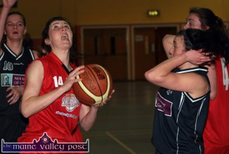 Don't Shoot: NUIG's top scorer, Ailish O'Reilly looks shocked as St. Mary's/Team Den Joe's American Style's Lorraine Scanlon lines up a score during their Women's National League Division 1 game at Castleisland Community Centre on Saturday night. ©Photograph: John Reidy