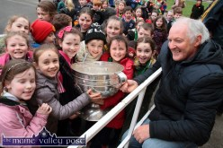 The importance of the Sam Maguire Cup to the culture and history of their county is not lost on these pupils of Gael Scoil Aogáin as Charlie Nelligan brings the famous trophy to the Castleisland School on Wednesday. ©Photograph: John Reidy