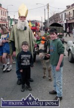 Cormac O'Mahony getting into the spirit of the occasion with the Lynch cousins, Seán and Kevin and their transport. ©Photograph: John Reidy