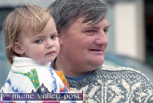 Little Christina Moore from Currow found the ideal vantage point in dad, Tom's arms while viewing the 1997 St. Patrick's Day Parade in Castleisland ©Photograph: John Reidy 17-3-1997