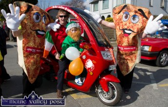 A Pizza the action: Den Joe and A.J. O'Connor setting out to the start of the parade in their Apache Pizza delivery trike on Tuesday. ©Photograph: John Reidy